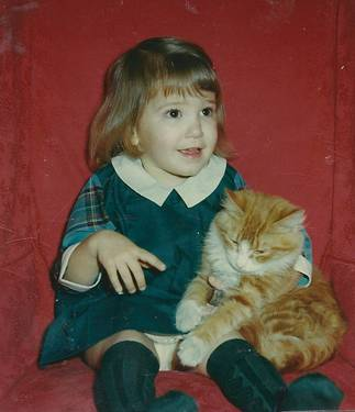 Michelle 3 years old with cat Aloysius
